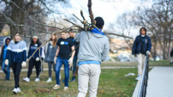 Students Cleaning Up Tree Branches