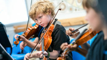 Young Students Playing Violins