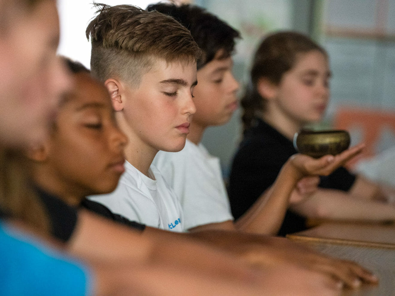 Group of students practice mindfulness