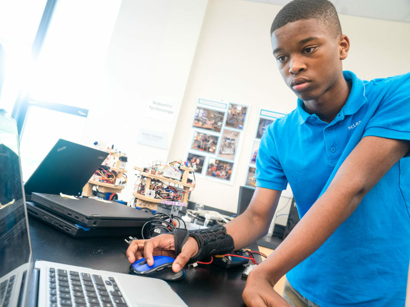 Student uses laptop during robotics project