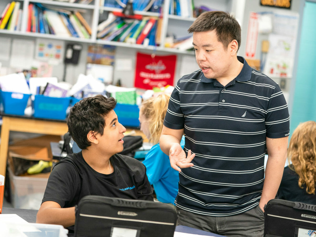 Student consults with teacher during class