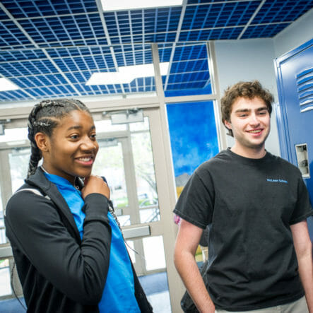 Two upper school students stand in McLean hallway
